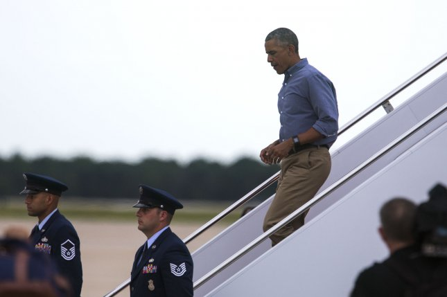 President Barack Obama departs Air Force One at Andrews Air Force Base in Maryland after a trip to Florida in June. Obama said he plans to cast an early ballot by mail in Chicago during a trip there on Friday. File photo by Jim Lo Scalzo/UPI