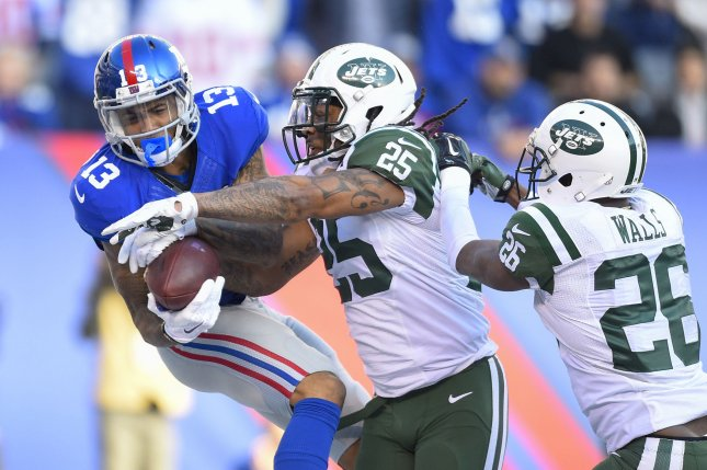 New York Giants wide receiver Odell Beckham Jr. (13) tries to catch a pass as New York Jets cornerback Darrin Walls (26) and strong safety Calvin Pryor (25) defend in the second quarter on December 6, 2015 at MetLife Stadium in East Rutherford, New Jersey. File photo by Rich Kane/UPI