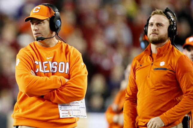 Head coach Dabo Swinney of the Clemson Tigers (L) stands on the field in the game against the Alabama Crimson Tide at the 2017 College Football Playoff National Championship Game on January 9, 2017 in Tampa, Florida. Photo by Mark Wallheiser/UPI