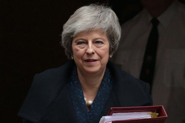 British Prime Minister Theresa May leaves No.10 Downing St. to face questions from her fellow politicians after receiving a No Confidence vote on her leadership on Wednesday morning. Photo by Hugo Philpott/UPI