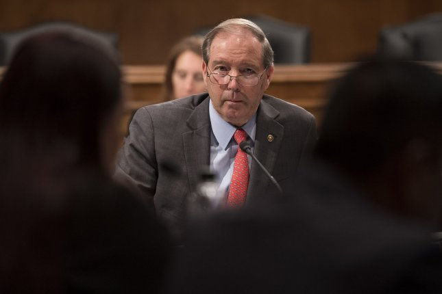 Sen. Tom Udall, D-N.M., vice chairman of the Senate Indian Affairs Committee, joined Native American leaders Friday in calling for the end of the partial federal government shutdown. Photo by Kevin Dietsch/UPI