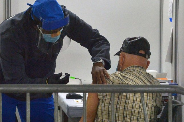 Some people, including organ transplant recipients, may need a booster dose of the COVID-19 vaccine, according to a new study. File photo by Jim Ruymen/UPI