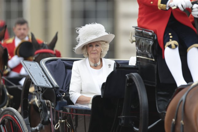 Camilla, duchess of Cornwall, travels in an open state carriage during the annual Trooping the Color to celebrate the queen's 90th birthday celebrations at The Mall in London on June 11, 2016. The duchess turns 74 on July 17. File Photo by Hugo Philpott/UPI
