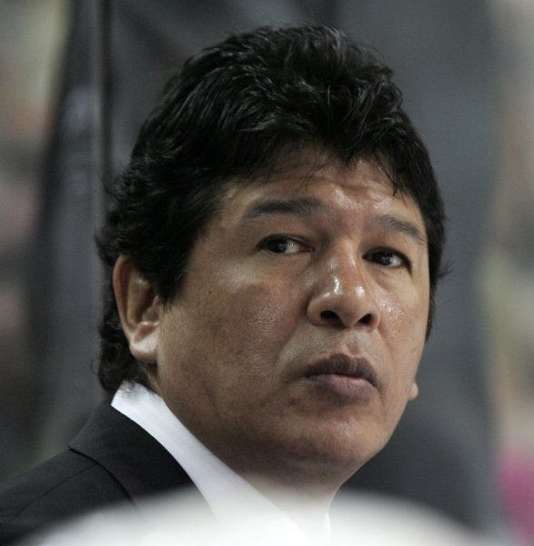 Head Coach Ted Nolan of the New York Islanders watches from behind the bench against the Buffalo Sabres in the 2nd period in game one of the Eastern Conference quarterfinals at the HSBC Arena in Buffalo on April 12, 2007. (UPI Photo/Jerome Davis)