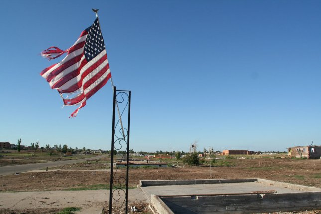 An American flag and foundations from homes are all that remains in a neighborhood in Joplin, Missouri on August 15, 2011. A tornado on May 22, 2011 claimed 160 lives. UPI/Tom Uhlenbrock