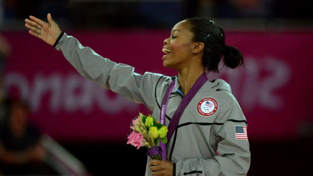USA's Gabrielle Douglas smiles as she receives her gold medal in the Women's Gymnastics Individual All-Around event at the North Greenwich Arena during the London 2012 Summer Olympics in Greenwich, London on August 2, 2012. Russians Victoria Komova won the silver and Aliya Mustafina won the bronze. UPI/Pat Benic