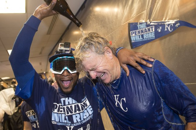 Kansas City Royals' Alcides Escobar pours champaign on first base coach Rusty Kuntz as they celebrate in the clubhouse after the Royals won the American Leave Championship Series after defeating the Toronto Blue Jays 4-3 in game 6 at Kaufman Stadium in Kansas City on October 23, 2015. Hosmer drove home the game winning run. Photo by Kevin Dietsch/UPI
