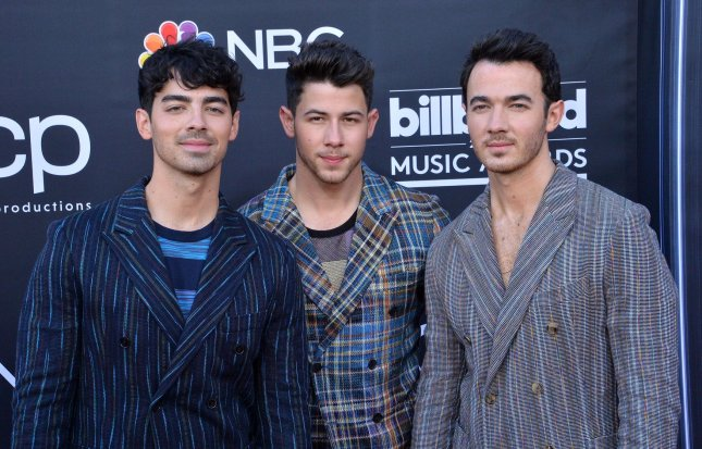 Pop music stars Joe Jonas, Nick Jonas and Kevin Jonas, pictured here at the 2019 Billboard Music Awards in Las Vegas, have the No. 1 album -- Happiness Begins -- in the United States this week. File Photo by Jim Ruymen/UPI