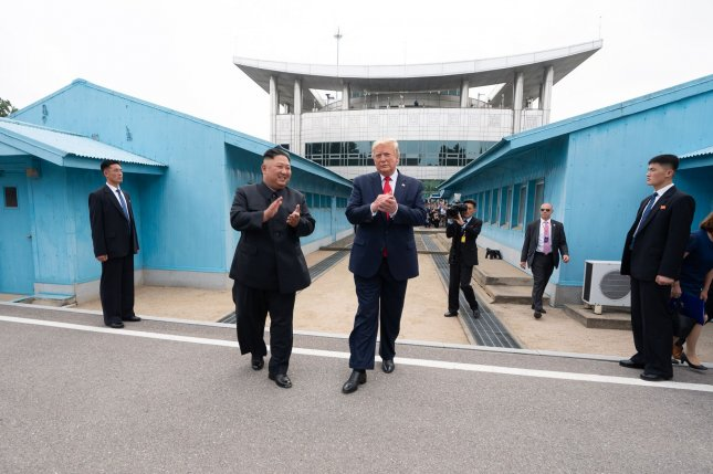 Donald Trump becomes the first sitting U.S. president to step foot on North Korean soil as he walks with North Korean leader Kim Jong Un at the Korean Demilitarized Zone. Photo by Shealah Craighead/White House/UPI