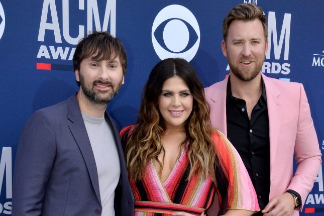 Lady A members, left to right, Dave Haywood, Hillary Scott and Charles Kelley attend the 54th annual Academy of Country Music Awards on April 2019. The band, previously known as Lady Antebellum, are suing blues singer Anita White who also goes by Lady A. File Photo by Jim Ruymen/UPI