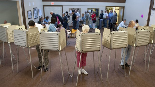 Voters cast their ballots in Wisconsin's recall election on June 5, 2012 in Caledonia, Wisconsin. Republican Gov. Scott Walker, the third governor in U.S. history to face a recall election, is opposed by Democratic challenger, Milwaukee Mayor Tom Barrett. UPI/Brian Kersey