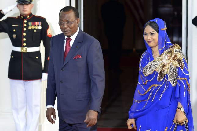 Chad's President Idriss Deby Itno and First Lady Hinda Deby Itno greet the press as they arrive at the White House for a State Dinner on behalf of the US-Africa Leaders Summit, August 5, 2014, in Washington, DC. Photo by Mike Theiler/UPI