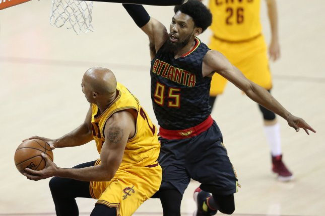 Cleveland Cavaliers' Richard Jefferson attempts to put up a shot while defended by DeAndre Bembry of the Atlanta Hawks during the second half at Quicken Loans Arena in Cleveland on April 7, 2017. File photo by Aaron Josefczyk/UPI