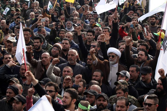 People attend a joint funeral procession of slain Abu Mahdi al-Muhandis and Qassem Soleimani in central Baghdad on Saturday. Photo by Ibrahim Jassam/UPI