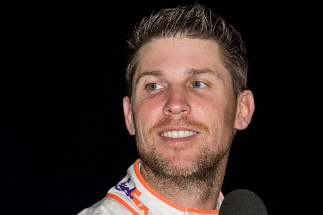 NASCAR Cup Series star Denny Hamlin held off retired driver Dale Earnhardt Jr. to win the iRacing Pro Series Invitational's Dixie Vodka 150 on Sunday at iRacing's virtual Homestead-Miami Speedway. File Photo by Edwin Locke/UPI