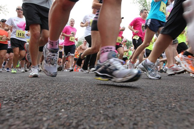 Runners begin the Susan G. Komen Race for the Cure in St. Louis, the largest Koman Race in the United States with over 64 thousand people participating in 2011, raising $2.3 million. UPI/Bill Greenblatt