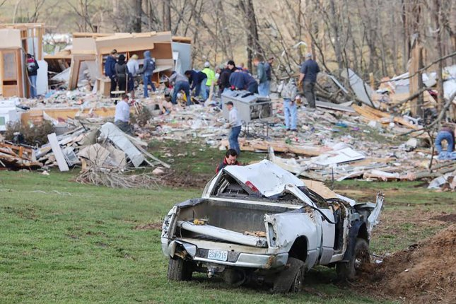 A destroyed pickup truck sits in a field as volunteers clear debris in Perryville, Mo., on March 1 following a tornado that killed at least one, injured 20 and damaged nearly 100 homes on February 28. The National Centers for Environmental Information said five separate weather disasters caused a record more than $5 billion in damages for the first three months of 2017. File Photo by Rick Meyer/UPI
