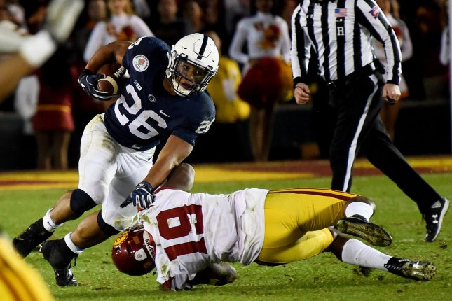 Penn State Nittany Lions running back Saquon Barkley (26) is stopped for no gain on third down by the Trojans' Michael Hutchings (19) in the fourth quarter during the 2017 Rose Bowl in Pasadena, California on January 2, 2017. File photo by Juan Ocampo/UPI