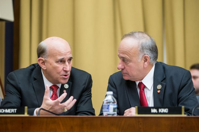 Rep. Steve King, right, talks with Rep. Louie Gohmert before a hearing on the Justice Department's investigation of Russia's interference in the 2016 U.S. presidential election on Capitol Hill in Washington, DC on December 13, 2017. House Republicans voted unanimously Monday to remove King from all of his committee assignments. Photo by Erin Schaff/UPI