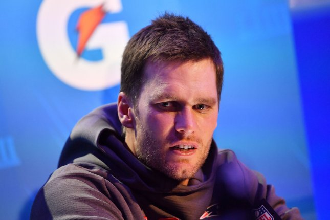 New England Patriots quarterback Tom Brady speaks to reporters after arriving at Super Bowl Opening Night Monday at the State Farm Arena in Atlanta. Photo by Kevin Dietsch/UPI
