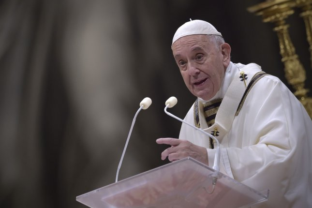 Pope Francis delivers a message on the unconditionalnature of God's love on Christmas Eve. Photo by Stefano Spaziani/UPI