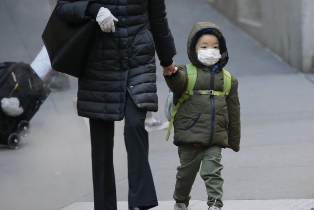 A child wears a face mask to prevent spread of COVID-19 in New York City in November 2020. File Photo by John Angelillo/UPI