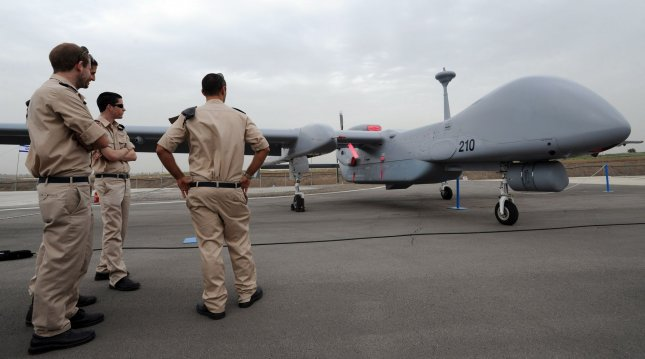 Israeli Air Force soldiers look at an Israeli made unmanned aerial vehicle, the Heron TP, during the drone's induction ceremony into the Israeli Air Force at the Tel Nof Air Force Base, February 21, 2010. The large drone is built by the Israel Aerospace Industries, IAI, and is capable of flying to Iran. It has a wingspan of 86 feet, the size of a passenger jet and can fly 20 consecutive hours. The drone is primarily used for surveillance and carrying payloads. UPI/Debbie Hill
