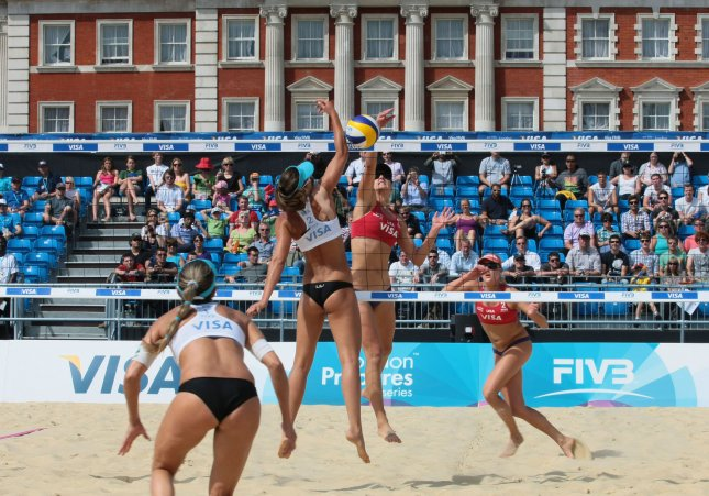 Members of the American Olympic beach volleyball team in action against Brazil in the Visa FIVB Beach Volleyball International test event in London's Horseguard's parade on Wednesday August 10 2011. UPI/Hugo Philpott