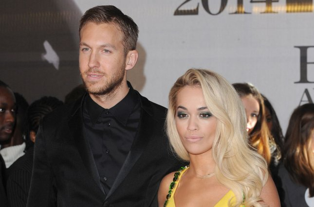 Scottish DJ, singer/songwriter Calvin Harris and girlfriend British singer/songwriter Rita Ora attend The brit Awards 2014 at The O2 Arena in London on February 19, 2014. UPI/Paul Treadway