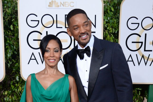 Jada Pinkett Smith (L) and husband Will Smith at the Golden Globe Awards on January 10. The actress will reprise Fish Mooney on Gotham. File Photo by Jim Ruymen/UPI