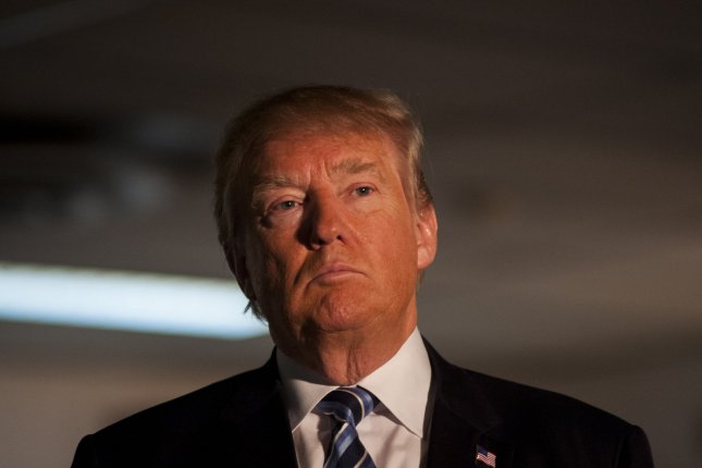 Republican presidential candidate Donald Trump slammed Apple's refusal to comply a federal court order demanding that the tech company break encryption on the iPhone used by the terrorists involved in the San Bernardino attack two months ago. Photo by Ryan McBride/UPI