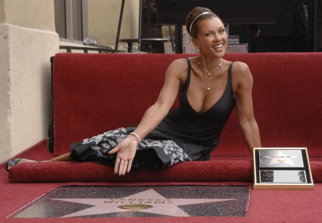 Actress Vanessa Williams poses next to her star at ceremony on the Hollywood Walk of Fame in Los Angeles on March 19, 2007. Photo by Phil McCarten/UPI