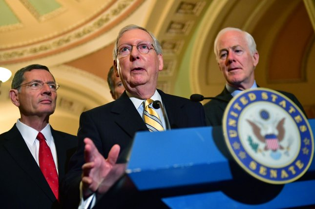 Senate Republican leader Mitch McConnell, R-Ky, speaks to the media following a Democratic meeting on Capitol Hill in Washington, D.C., on Wednesday. The Senate on Thursday approved $15 billion in disaster relief for Hurricanes Harvey and Irma. Photo by Kevin Dietsch/UPI