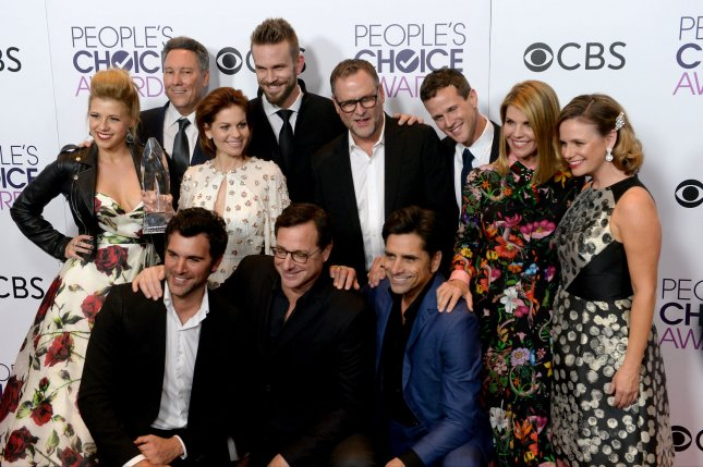 (Back L-R) Actress Jodie Sweetin, producer Jeff Franklin, actors Candace Cameron Bure, John Brotherton, Dave Coulier, Scott Weinger, Lori Loughlin, Andrea Barber and (front L-R) actors Juan Pablo Di Pace, Bob Saget and John Stamos appear backstage with their award for Favorite Premium Comedy Series for Fuller House during the 43rd annual People's Choice Awards in Los Angeles on January 18. File Photo by Jim Ruymen/UPI