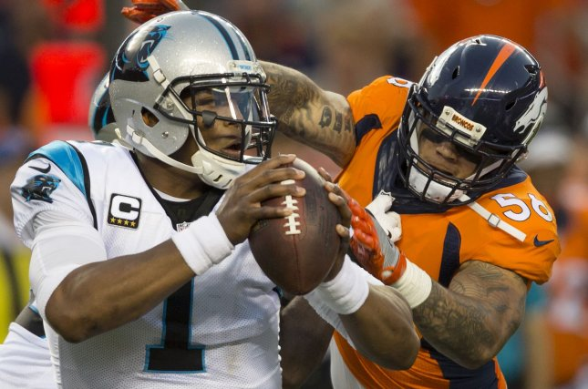 Denver Broncos linebacker Shane Ray (R) pressures Carolina Panthers quarterback Cam Newton in the first quarter at the NFL's season opener and Super Bowl 50 rematch at Sports Authority Field at Mile High in Denver on September 8, 2016. File photo by Gary C. Caskey/UPI