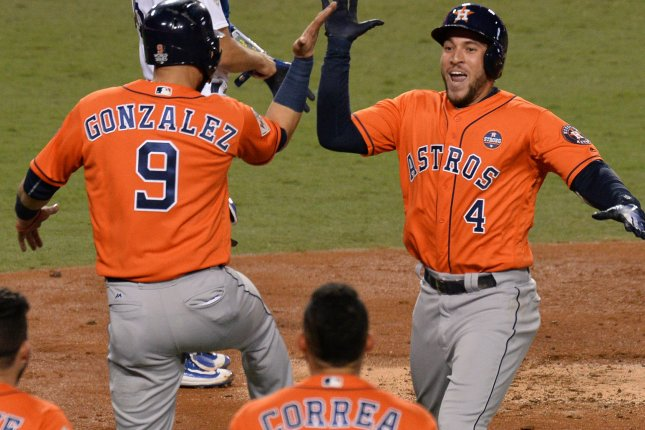 Houston Astros center fielder George Springer (4) celebrates his two-run home run with Marwin Gonzalez (9) in the second inning against the Los Angeles Dodgers in the 2017 MLB World Series Game 7 Wednesday at Dodger Stadium in Los Angeles. Photo by Jim Ruymen/UPI