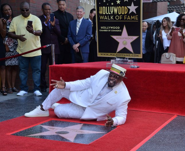 Cedric The Entertainer lies down next to his star during an unveiling ceremony honoring him with the 2,640th star on the Hollywood Walk of Fame in Los Angeles on Thursday. Photo by Jim Ruymen/UPI