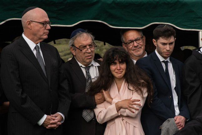Members of the Kaye family, daughter Hannah (C) and her father, Howard (second from left), attend the funeral service for Lori Gilbert Kaye, who was killed in a shooting at the Chabad of Poway Synagogue in California. File Photo by Ariana Drehsler/UPI