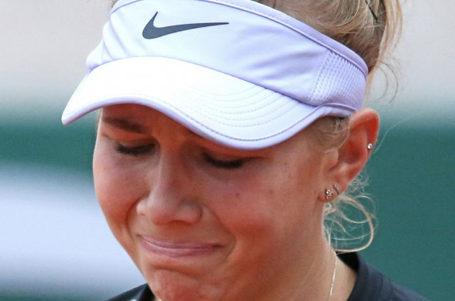 Amanda Anisimova of the U.S. reacts after a shot during her French Open women's semi-finals match against Ashleigh Barty of Australia at Roland Garros in Paris on Friday. Photo by David Silpa/UPI