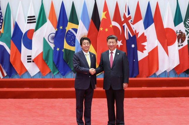 Chinese President Xi Jinping (R) is expected to hold a summit in Japan with Japanese Prime Minister Shinzo Abe in the spring. File Photo by Ma Zhancheng/UPI
