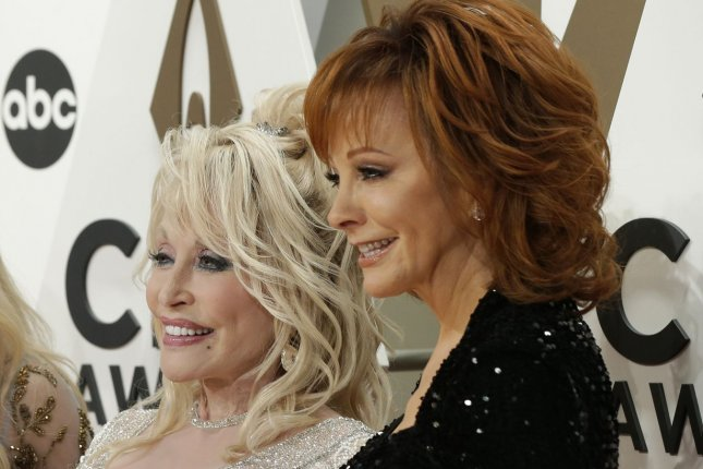 Dolly Parton (L) teased her collaboration with Reba McEntire on Watch What Happens Live. File Photo by John Angelillo/UPI