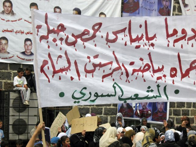 Mothers, wives, sisters and children of Syrian anti-government men who were arrested by the security forces hold banners and shout slogans during a protest demanding to release them in the town of Nawa, Darra city, Syria, on May 4, 2011. UPI
