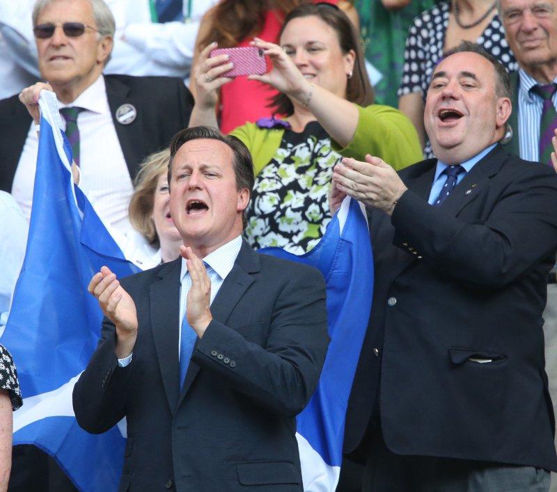 British Prime Minister David Cameron cheers for Andy Murray who won the 2013 Wimbledon Men's Singles Final beating Novak Djokovic in London on July 7, 2013. Murray won 6-4 7-5 6-4. UPI/Hugo Philpott