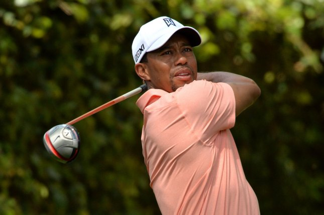 Tiger Woods, shown in a tournament in April 2013, is No. 1 on the Forbes list of highest paid athletes. UPI/Kevin Dietsch