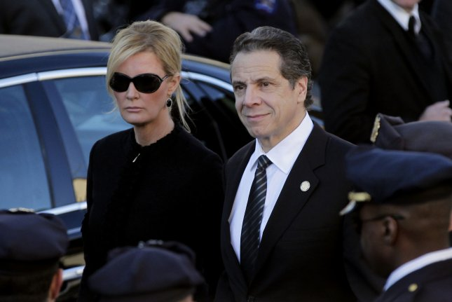 Sandra Lee and Governor Andrew Cuomo exit the church following the funeral of New York Police Officer Rafael Ramos at Christ Tabernacle Church in New York City on Dec. 27, 2014. Photo by John Angelillo/UPI