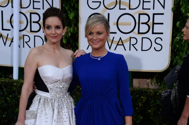 Tina Fey (L) and Amy Poehler attend the 72nd annual Golden Globe Awards at the Beverly Hilton Hotel in Beverly Hills on Jan. 11, 2015. Photo by Jim Ruymen/UPI