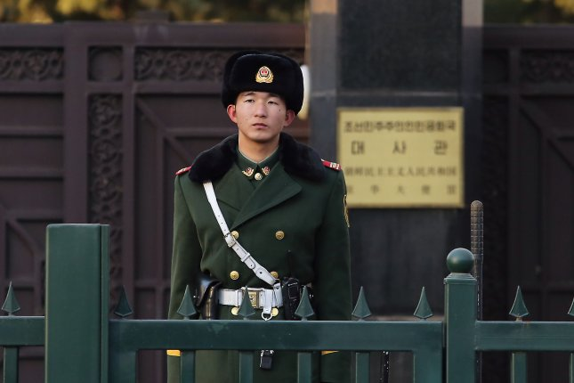 A Chinese soldier stands guard outside the North Korean embassy in Beijing on January 6, 2016. North Korea has been combating propaganda broadcasts from Seoul with propaganda of its own: leaflet drops into the South via balloon. Photo by Stephen Shaver/UPI