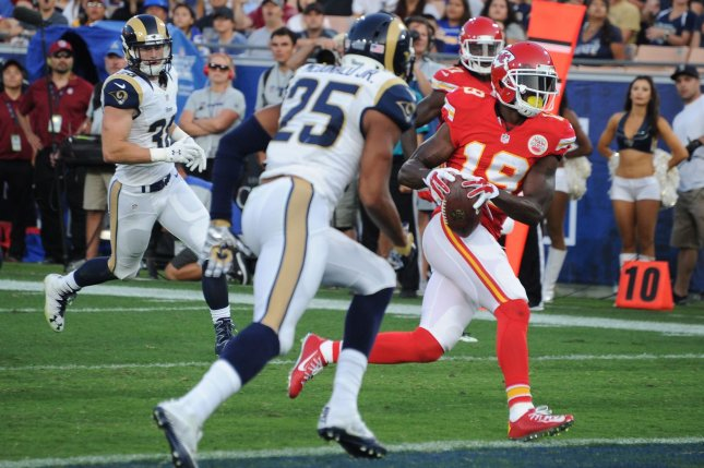 Kansas City Chiefs' receiver Jeremy Maclin (19) scores a touchdown past Los Angeles Rams' cornerback T.J. McDonald (25) in the first quarter at the Los Angeles Coliseum in Los Angeles on August 20, 2016. Photo by Jon SooHooUPI