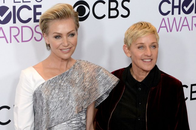Ellen DeGeneres (R) and Portia de Rossi attend the People's Choice Awards on January 18. The couple dedicated sweet posts to each other on their ninth wedding anniversary Wednesday. File Photo by Jim Ruymen/UPI