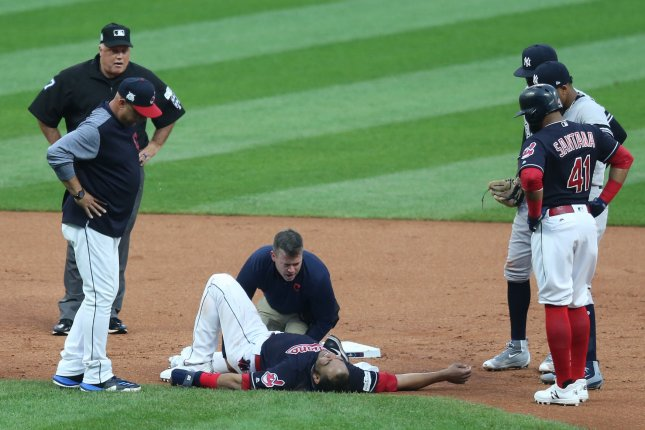 Cleveland Indians manager Terry Francona (L) looks on as the trainer examines Edwin Encarnacion at second base in the first inning during the ALDS Game two on October 6, 2017 in Cleveland. File photo by Aaron Josefczyk/UPI